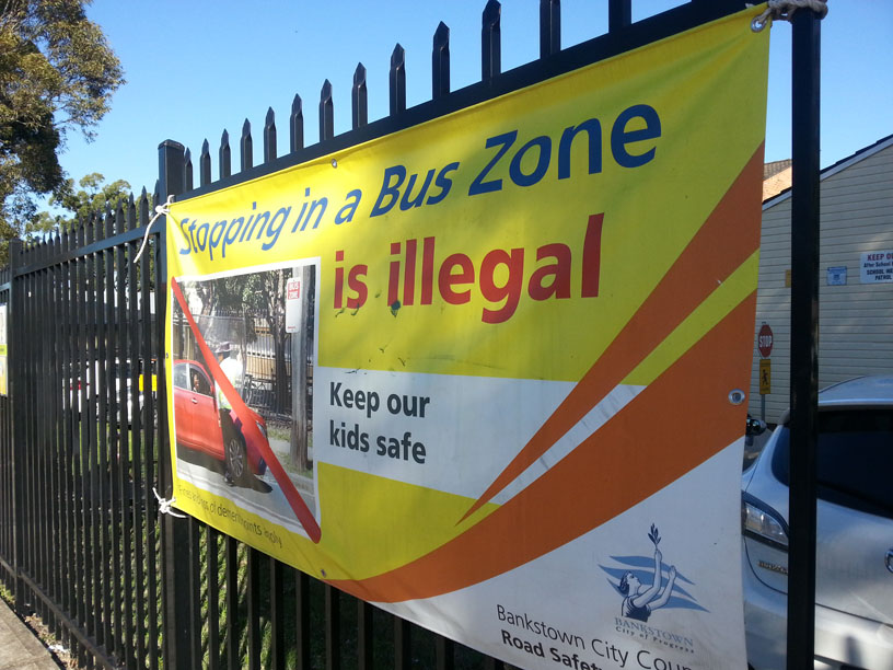 Banner -stopping in a bus zone is illegal